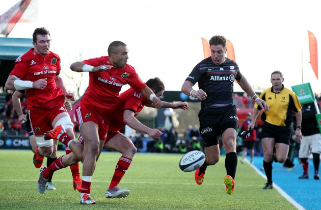 Simon Zebo and Felix Jones tackle Chris Wyles of as he kicks the ball through for Chris Ashton to score a try