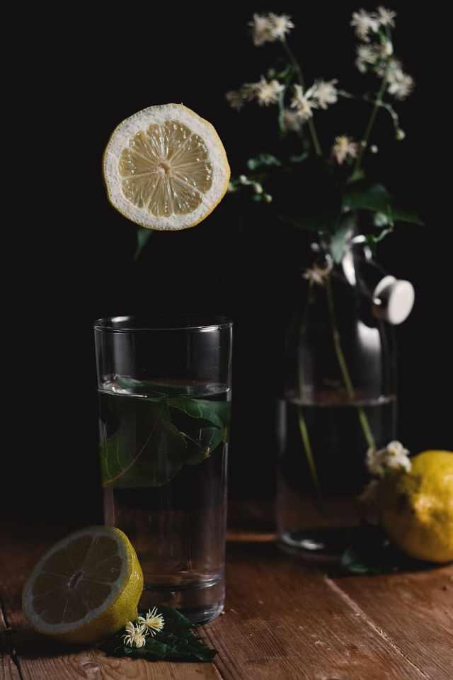HD wallpaper: sliced lemon beside drinking glass, bottle, water ...