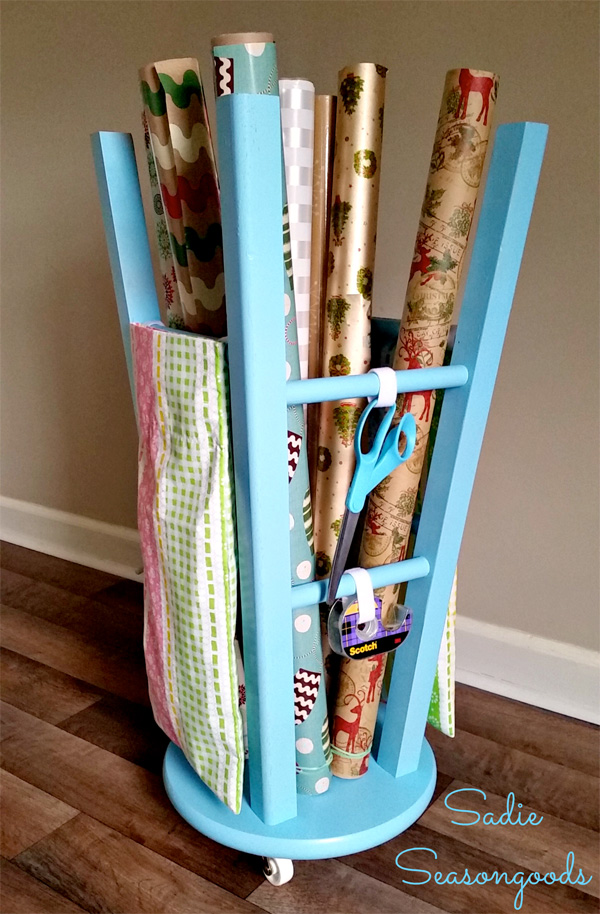 DIY gift wrap organizer created from a wooden stool