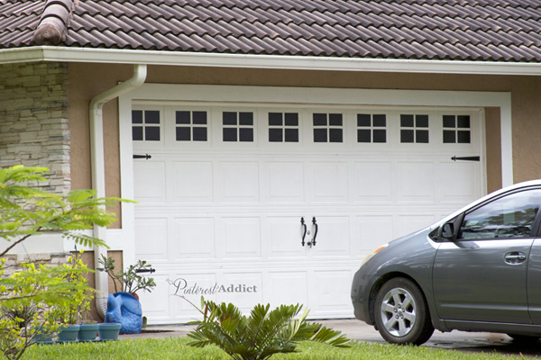 A garage door painted to look like it has carriage details