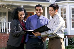 Couple looking at houses with a buyer's agent