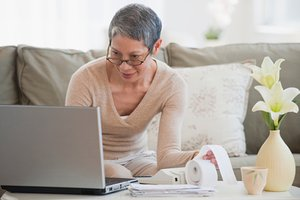 Woman in front of laptop in home