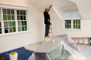 Homeowner painting room in his house