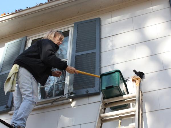 Washing the windows outside a house