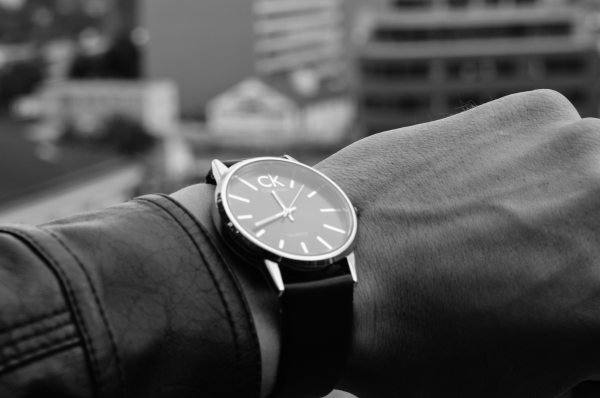 Person Wearing Black Strap Calvin Klein Analog Watch
