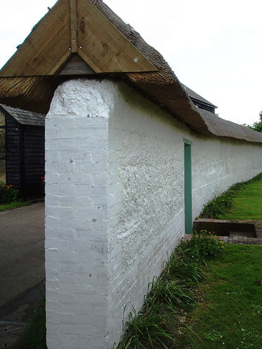 thatched cob wall  Heres another cob wall with brick pill  Flickr