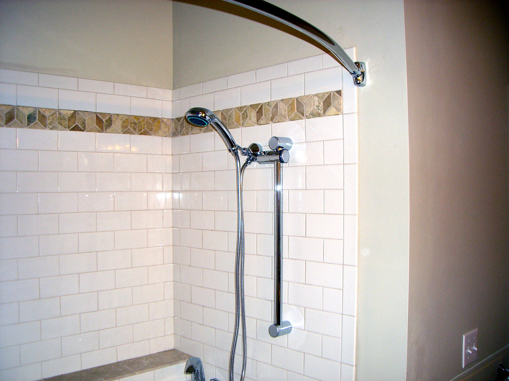 Walkin tub  Custom tile with a hand held shower