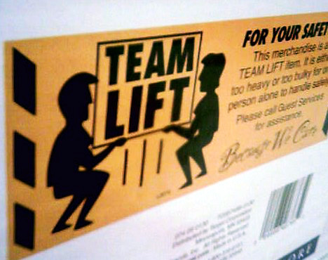 Team Lift  Team lift icon on flatpack furniture at