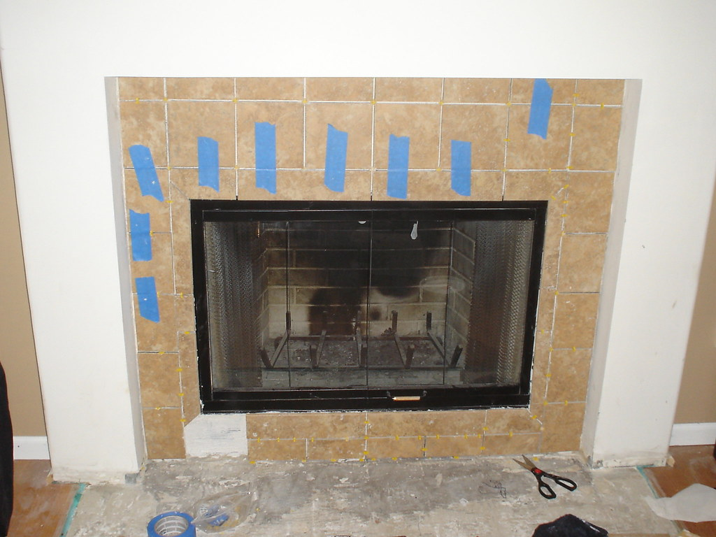 Almost done replacing the tile around the fireplace