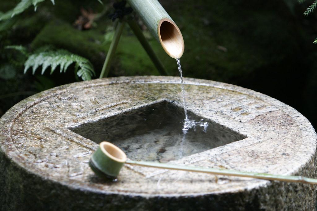 Ryoanji Temple in Kyoto  The stone basin in a gardenIt