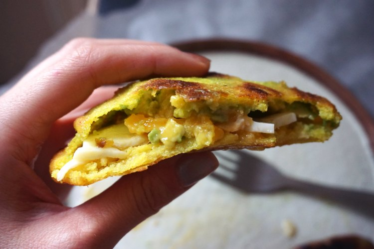 Gluten free arepas with egg, sausage and avocado