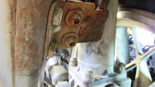 Loosen Muffler Mount Bolts to Position Exhaust Bracket Easier