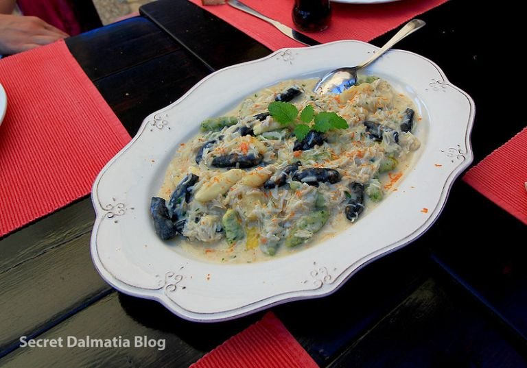 Home made tri-colori gnocchi with spider-crab sauce