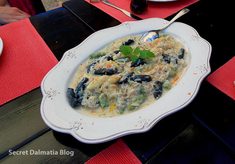 Home made tri-colori gnocchi with spider-crab sauce