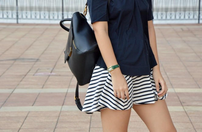 Striped skirt, charles & keith black leather back pack, green gucci watch, COS navy blouse
