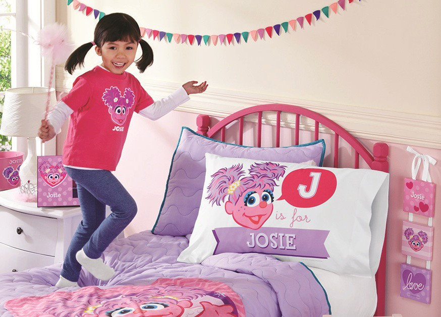 girl in Abby Cadabby Sesame Street personalized shirt with