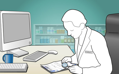 Pharmacist at desk reading letter with a magnifying glass