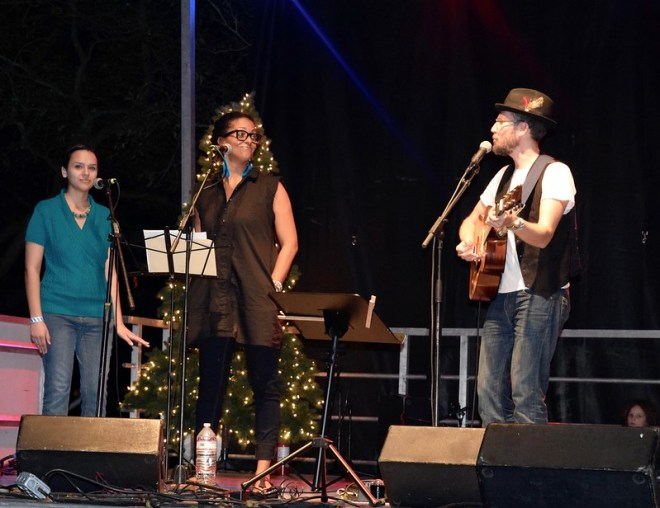 Krysta, Thais and Jason, singing at the Trail of Lights
