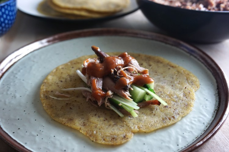 Gluten free Chinese crispy duck with pancakes, Ayam hoi sin sauce, spring onions and cucumber sticks