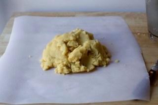 gather dough scraps into a pile