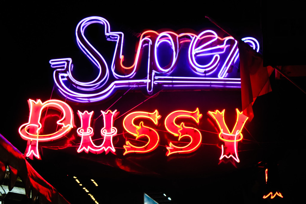 Super Pussy  One of the weird neon signs on the sex show