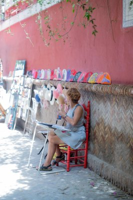 back alley artisan working in Seville spain