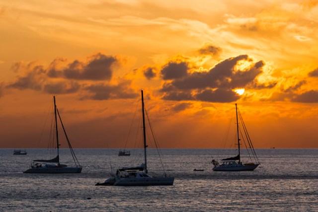 Sunset games at Nai Harn beach, Phuket island, Thailand