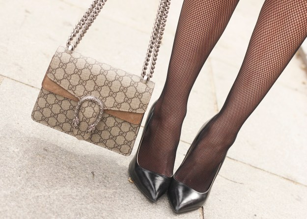 Ruffled striped shirt Fishnet tights black skirt heels gucci bag style fashion outfit 09