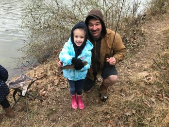 Photo of father and daughter at youth fishing rodeo