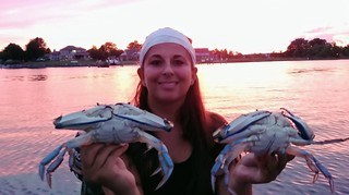 Photo of girl with her catch of blue crab