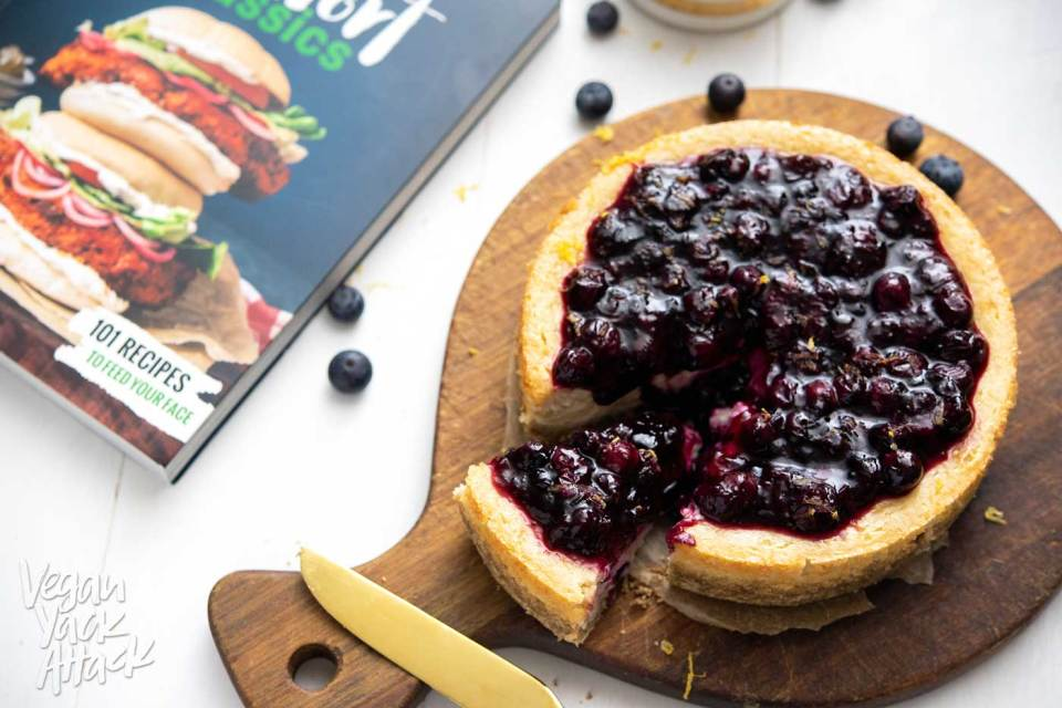 This vegan, Baked Blueberry Cheesecake is luscious and SO much like the traditional version! Plus, it's gluten-free! Indulge in this delectable dessert from Lauren Toyota's cookbook, Vegan Comfort Classics, and you won't be disappointed.