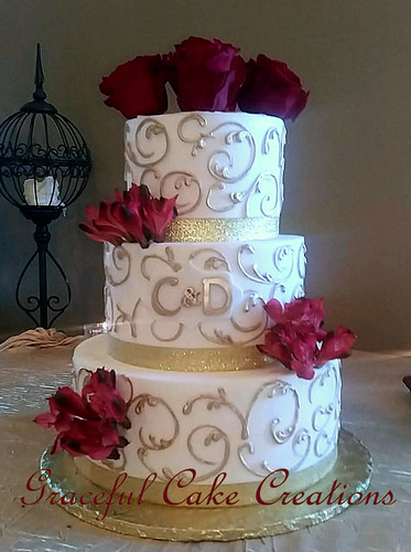 Elegant Ivory Butter Cream Wedding Cake with Gold Ribbon a