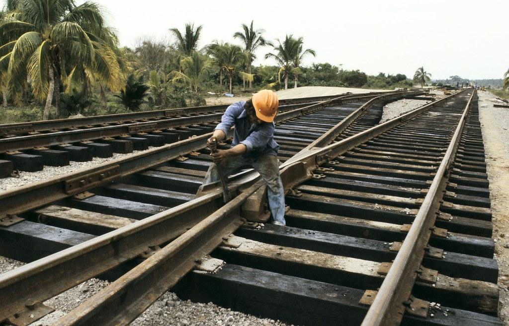 Falling Bridge Wallpaper Man Fixing Railroad Tracks Man Fixing Railroad Tracks