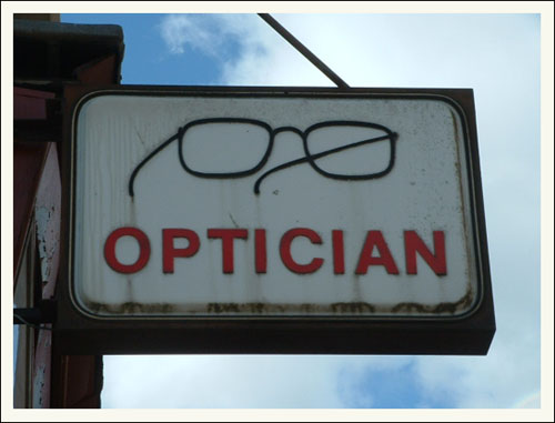 Optician  Old sign on Dumbarton Rd From 2003  Anne