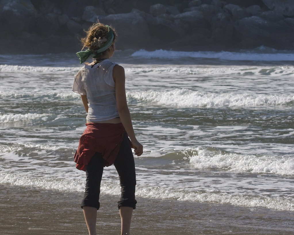 Pretty Young Girl Wading In The Water In Morro Bay CA