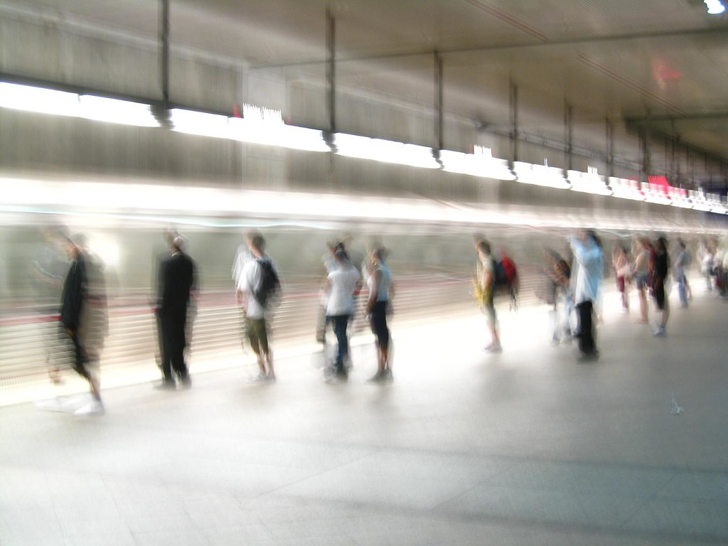 People are Train Waiting  The funky people are blurry