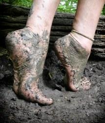 Feet Walking Barefoot in Mud