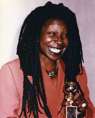 Whoopi Goldberg holding Golden Globe Award for Ghost