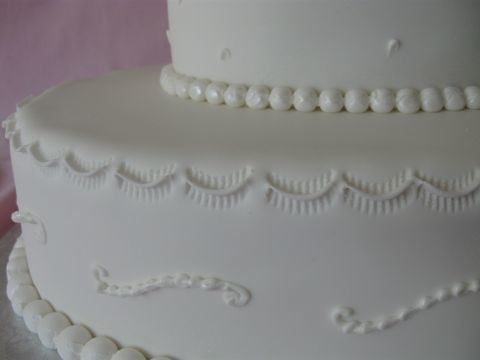 First Communion Cake  Close up of crimping scrolls and