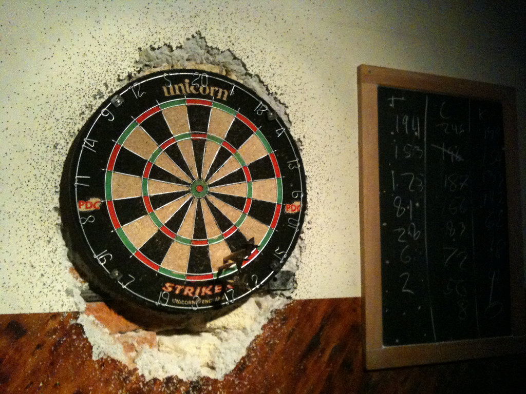 rsteds dart board  Well used dart board with no regard