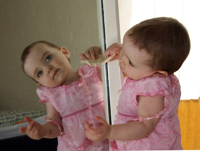 Toddler in mirror  Children start to become selfaware at