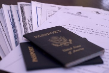 Two US passports on top of a pile of paperwork