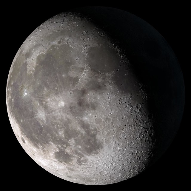 a Waning Gibbous moon is seen in the sky