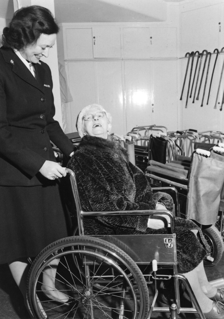 wheelchair equipment red metal chairs medical service, 1960s | a cross volunteer hel… flickr
