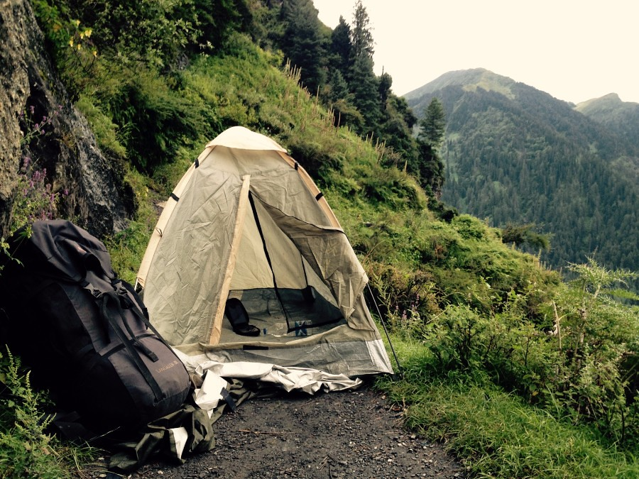 pitching a tent in the middle of a trail in himachal pradesh mountains