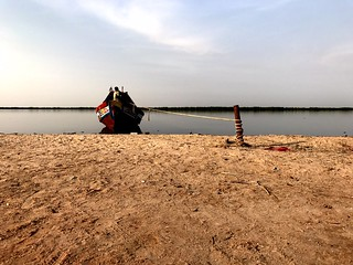 red boat moored at the bank of casamance river