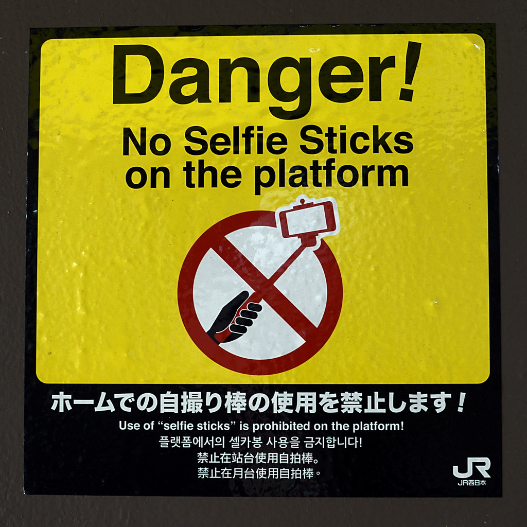 Danger! No Selfie Sticks on the platform sign at a Japan Rail station