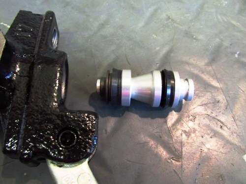 New Master Cylinder Piston Oriented for Installation in Master Cylinder