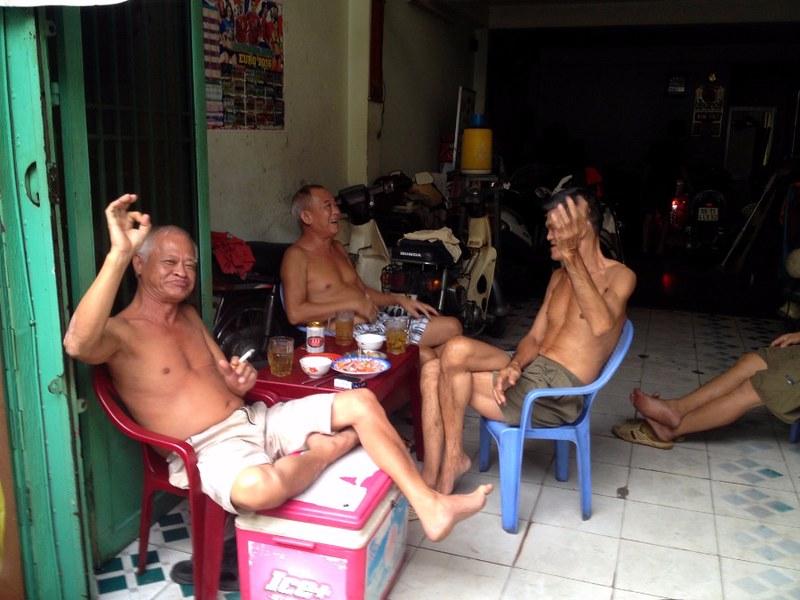 vietnamese men sitting idle and drinking in saigon