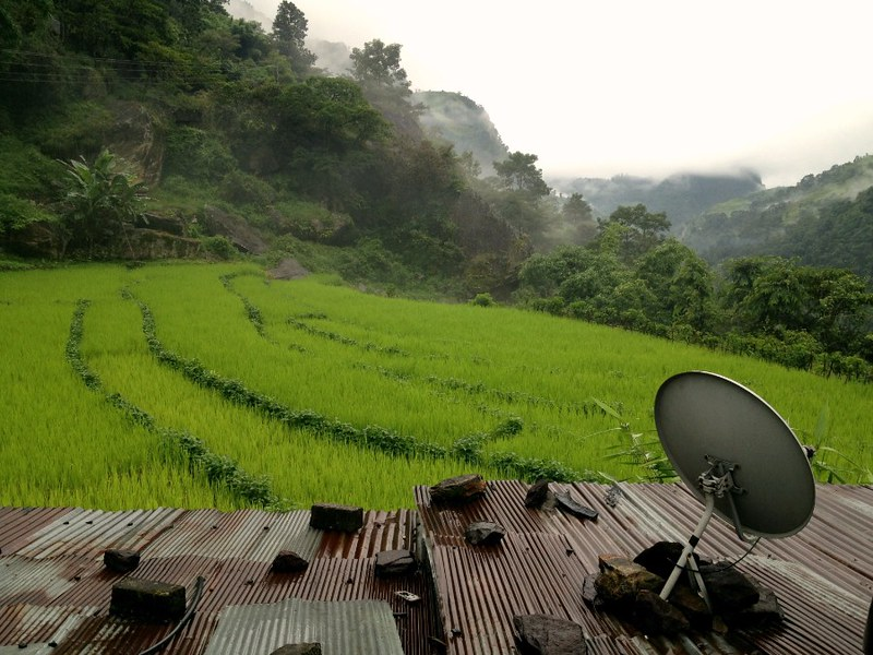 satellite dish and rice farms in annapurna village